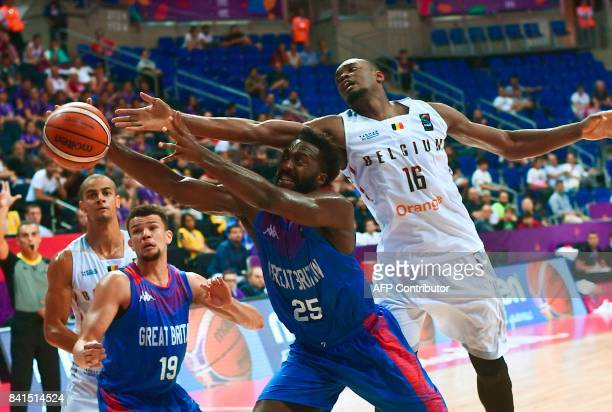 Great Britain's Gabe Olaseni vies for the ball with Belgium's Kevin Tumba during the FIBA Eurobasket 2017 men's group D basketball match between...