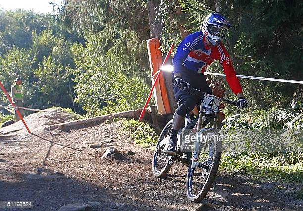 Great Britain's Gee Atherton competes during the men's elite downhill world championship race as part of the 2012 UCI Mountain Bike and Trials World...