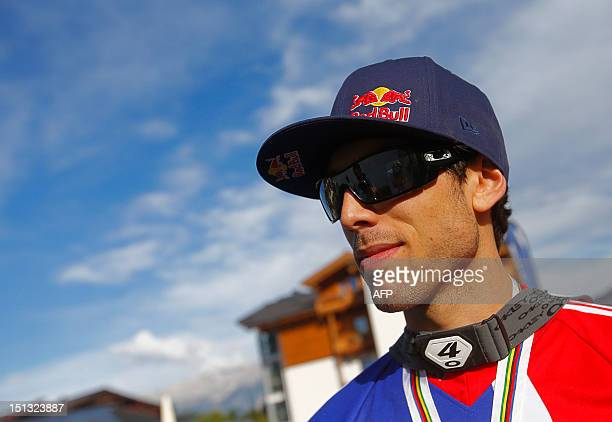 Great Britain's Gee Atherton looks on after finishing second of the men's elite downhill world championship race as part of the 2012 UCI Mountain...