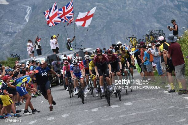 Great Britain's Geraint Thomas and cyclists ride up during the eighteenth stage of the 106th edition of the Tour de France cycling race between...