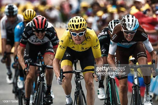 Great Britain's Geraint Thomas and France's Romain Bardet sprint in the last meters to place 2nd and third of the 19th stage of the 105th edition of...