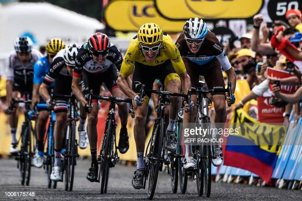 TOPSHOT Great Britain's Geraint Thomas and France's Romain Bardet sprint in the last meters to place 2nd and third of the 19th stage of the 105th...