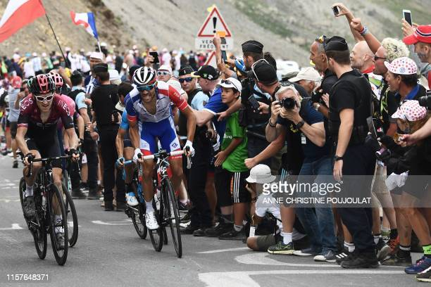 Great Britain's Geraint Thomas and France's Thibaut Pinot ride up to the Col du Galibier during the eighteenth stage of the 106th edition of the Tour...