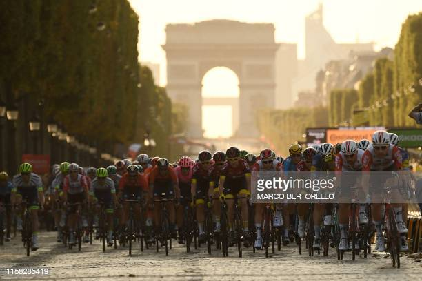 Great Britain's Geraint Thomas and the pack ride down the Champs Elysees with Arc de Triomphe in background during the 21st and last stage of the...
