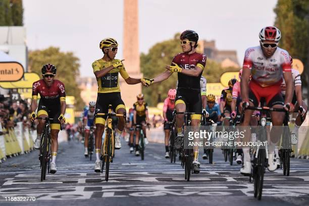 Great Britain's Geraint Thomas congratulates Colombia's Egan Bernal wearing the overall leader's yellow jersey as he celebrates his victory on the...