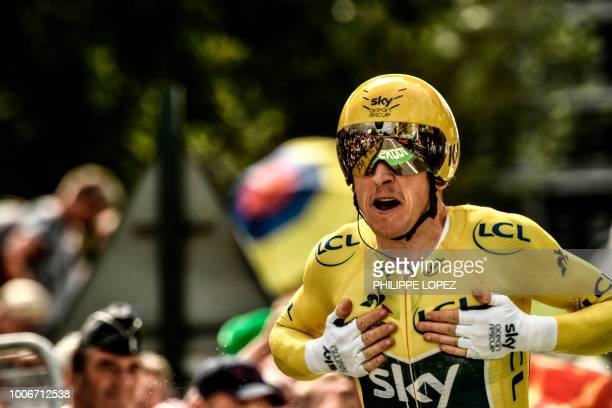 TOPSHOT Great Britain's Geraint Thomas crosses the finish line of the 20th stage of the 105th edition of the Tour de France cycling race a...
