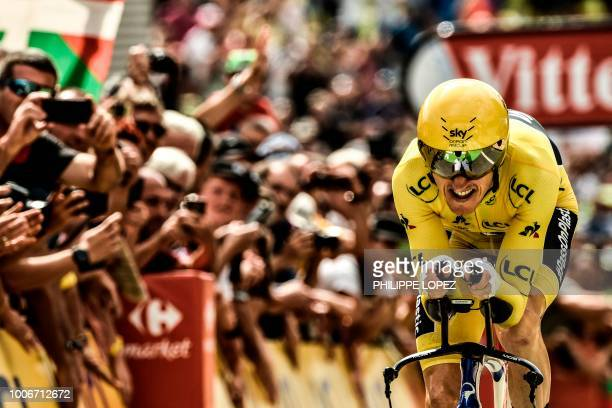 Great Britain's Geraint Thomas crosses the finish line of the 20th stage of the 105th edition of the Tour de France cycling race a 31kilometer...