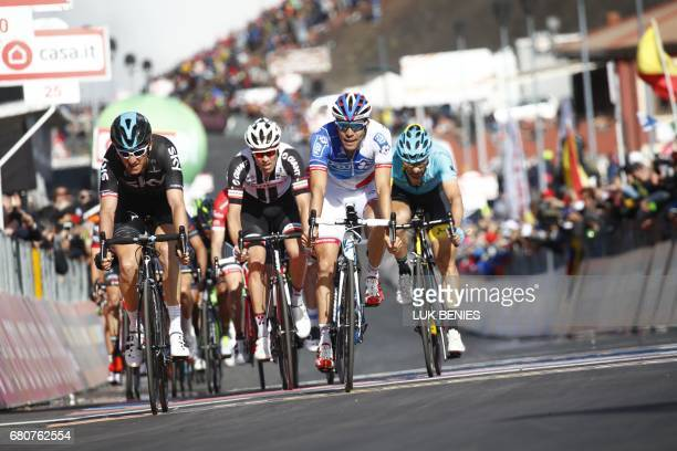Great Britain's Geraint Thomas of team Sky and France's Thibaut Pinot of team FDJ cross the finish line of the 4th stage of the 100th Giro d'Italia...