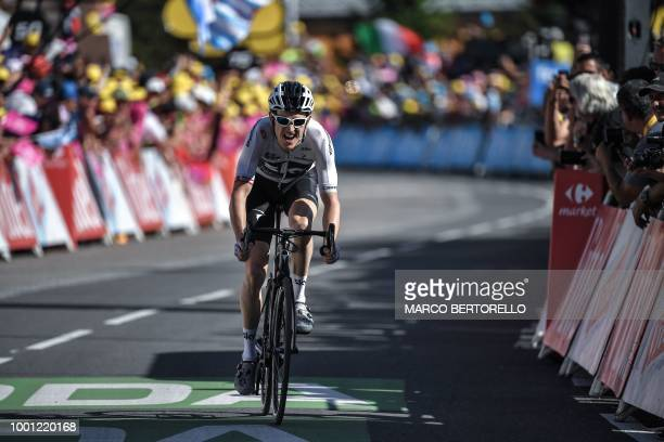 TOPSHOT Great Britain's Geraint Thomas rides in the last meters on his way to cross the finish line and win the eleventh stage of the 105th edition...