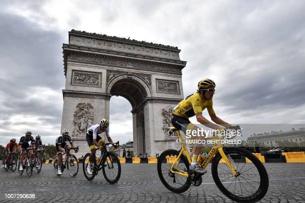 TOPSHOT Great Britain's Geraint Thomas rides past the Arc de triomphe monument during the 21st and last stage of the 105th edition of the Tour de...