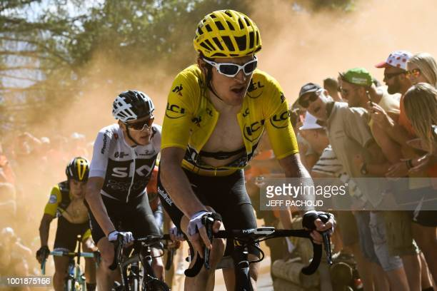 TOPSHOT Great Britain's Geraint Thomas wearing the overall leader's yellow jersey and Great Britain's Christopher Froome rides through the socalled...