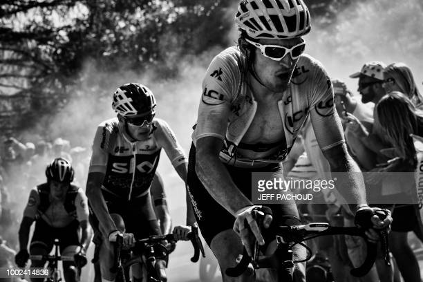 Great Britain's Geraint Thomas wearing the overall leader's yellow jersey and Great Britain's Christopher Froome rides through the socalled 'Dutch...