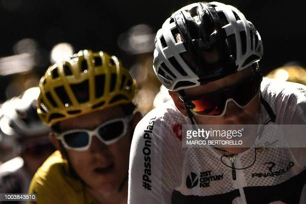 Great Britain's Geraint Thomas wearing the overall leader's yellow jersey and Great Britain's Christopher Froome ride during the 15th stage of the...
