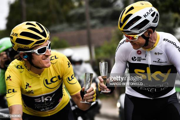 Great Britain's Geraint Thomas wearing the overall leader's yellow jersey and Great Britain's Christopher Froome drink champagne during the 21st and...