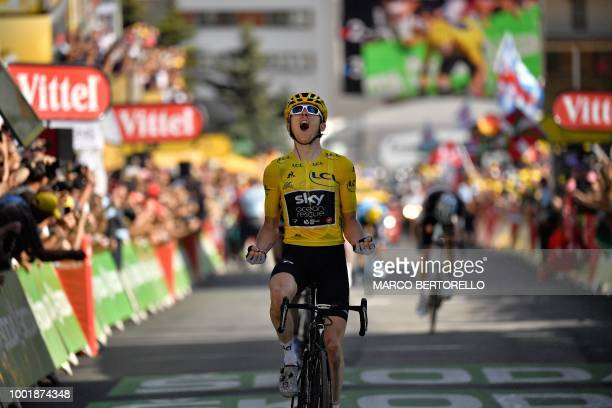 Great Britain's Geraint Thomas wearing the overall leader's yellow jersey celebrates as he crosses the finish line to win the twelfth stage of the...