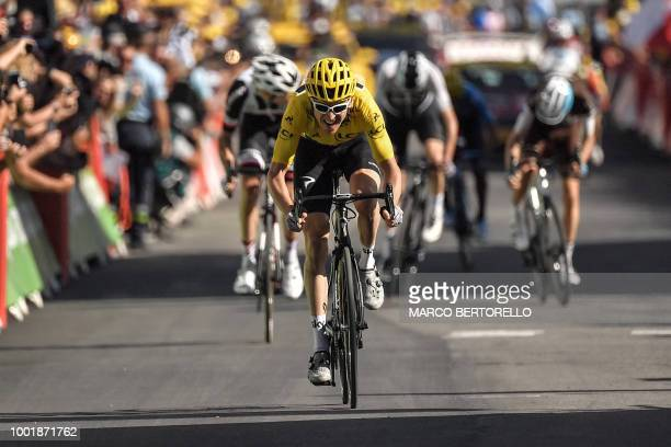 TOPSHOT Great Britain's Geraint Thomas wearing the overall leader's yellow jersey rides in the last meters on his way to win the twelfth stage of the...