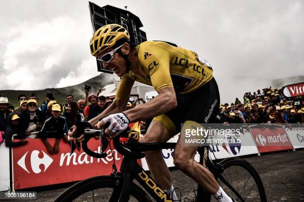 TOPSHOT Great Britain's Geraint Thomas wearing the overall leader's yellow jersey rides in the last meters to cross the finish line and place 3rd of...