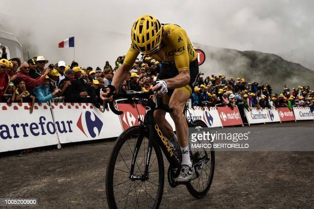 Great Britain's Geraint Thomas wearing the overall leader's yellow jersey rides in the last kilometers of the 17th stage of the 105th edition of the...