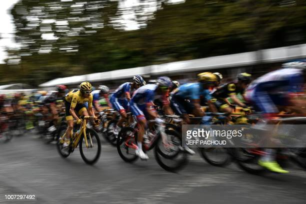 Great Britain's Geraint Thomas wearing the overall leader's yellow jersey rides in the pack during the 21st and last stage of the 105th edition of...