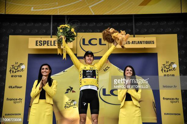 Great Britain's Geraint Thomas wearing the overall leader's yellow jersey celebrates on the podium after the 20th stage of the 105th edition of the...