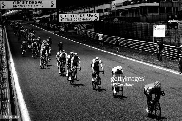 Great Britain's Geraint Thomas wearing the overall leader's yellow jersey ride on the Circuit de SpaFrancorchamps motorracing circuit during the 2125...