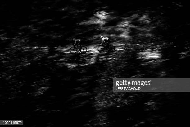 Great Britain's Geraint Thomas wearing the overall leader's yellow jersey rides down the Col de la Madeleine pass during the twelfth stage of the...