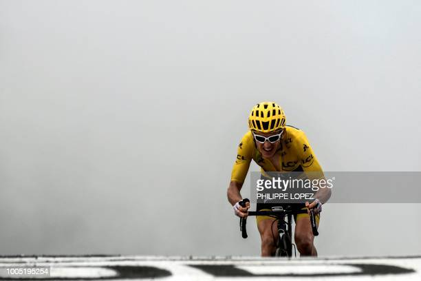 Great Britain's Geraint Thomas, wearing the overall leader's yellow jersey, crosses the finish line ta place third of the 17th stage of the 105th...