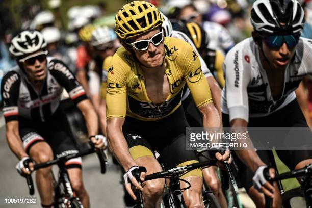 TOPSHOT Great Britain's Geraint Thomas wearing the overall leader's yellow jersey rides during the 17th stage of the 105th edition of the Tour de...