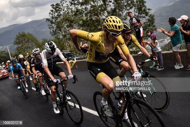Great Britain's Geraint Thomas wearing the overall leader's yellow jersey Netherlands' Steven Kruijswijk Great Britain's Christopher Froome and...