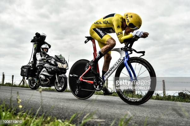 TOPSHOT Great Britain's Geraint Thomas wearing the overall leader's yellow jersey rides during the 20th stage of the 105th edition of the Tour de...
