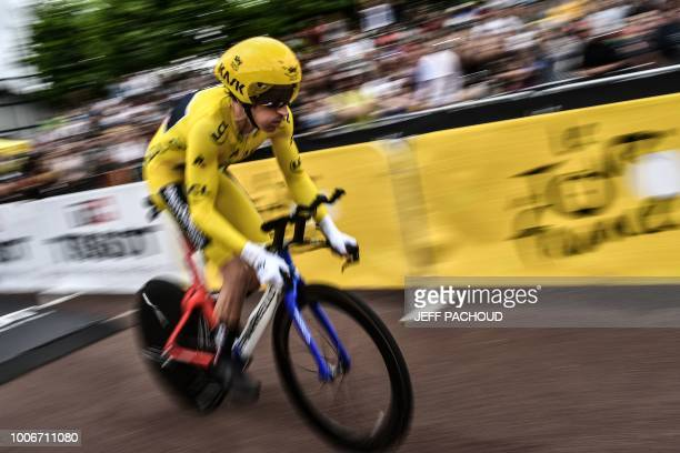 TOPSHOT Great Britain's Geraint Thomas wearing the overall leader's yellow jersey takes the start of the 20th stage of the 105th edition of the Tour...
