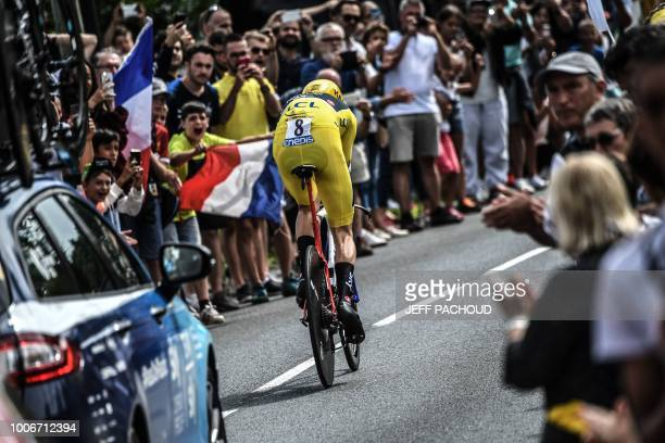 Great Britain's Geraint Thomas, wearing the overall leader's yellow jersey, rides during the 20th stage of the 105th edition of the Tour de France...
