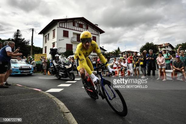 Great Britain's Geraint Thomas wearing the overall leader's yellow jersey rides during the 20th stage of the 105th edition of the Tour de France...