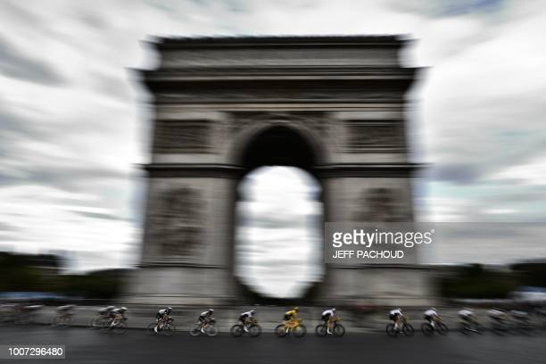 Great Britain's Geraint Thomas wearing the overall leader's yellow jersey rides past the Arc de triomphe monument during the 21st and last stage of...