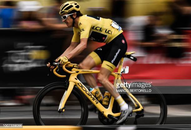 Great Britain's Geraint Thomas wearing the overall leader's yellow jersey rides during the 21st and last stage of the 105th edition of the Tour de...