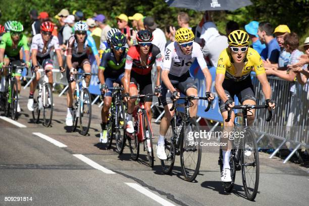 Great Britain's Geraint Thomas wearing the overall leader's yellow jersey Great Britain's Christopher Froome Australia's Richie Porte Colombia's...