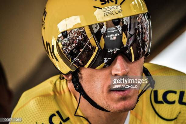 Great Britain's Geraint Thomas wearing the overall leader's yellow jersey prepares to take the start of the 20th stage of the 105th edition of the...