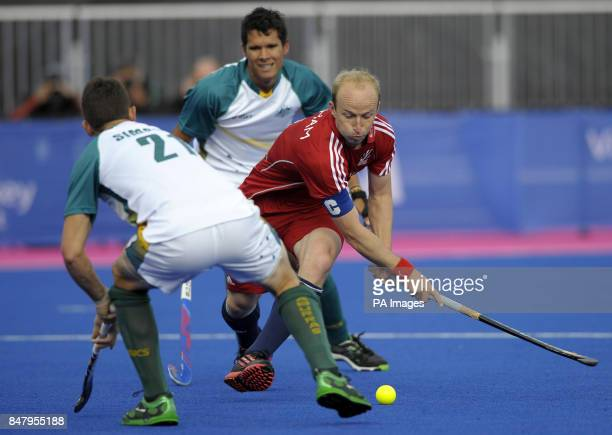 Great Britain's Glenn Kirkham shoots at goal despite the attentions of Australia's Liam de Young during the Visa International Invitational Hockey...