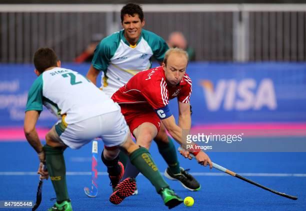 Great Britain's Glenn Kirkham shoots under pressure against Australia's Glenn Simpson during the Visa International Invitational Hockey Tournament at...