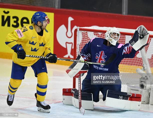 Great Britain's goalkeeper Ben Bowns makes a save during the IIHF Men's Ice Hockey World Championships preliminary round group A match between Sweden...