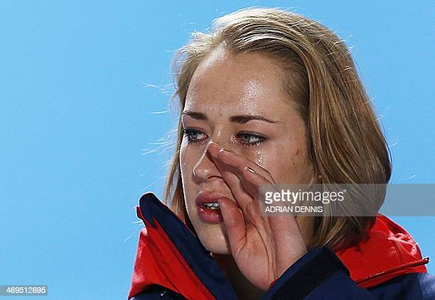 Great Britain's gold medalist Elizabeth Yarnold cries as she poses on the podium during the Women's Skeleton Medal Ceremony at the Sochi medals plaza...