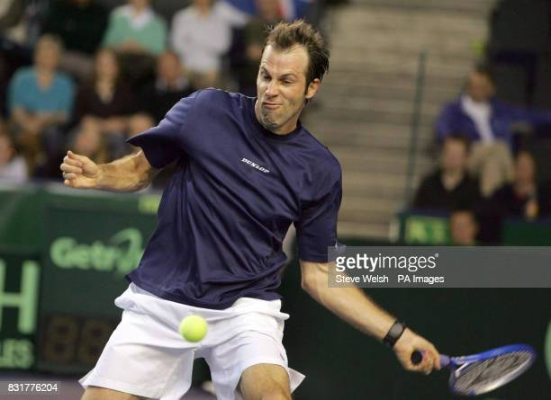 Great Britain's Greg Rusedski in action with Serbia Montenegro's Janko Tipsarevic during the first day of the Davis Cup at the Braehead Arena Glasgow...