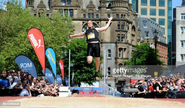 Great Britain's Greg Rutherford competes in the Long Jump in Albert Square during the BT Great CityGames in Manchester City Centre