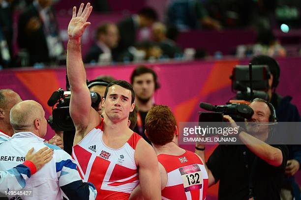 Great Britain's gymnast Kristian Thomas waves to the crowd after team GB won the bronze during the men's team final of the artistic gymnastics event...