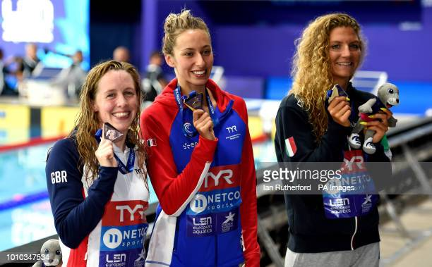 Great Britain's Hannah Miley with her bronze medal France's Fantine Lesaffre with her gold medal and Italy's Ilaria Cusinato with her silver medal...