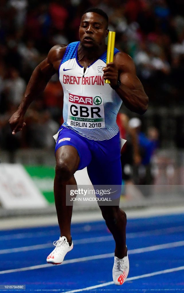 Great Britain's Harry Aikines-Aryeetey crosses the finish line first during the men's 4x100m relay final during the European Athletics Championships at the Olympic stadium in Berlin on August 12, 2018.