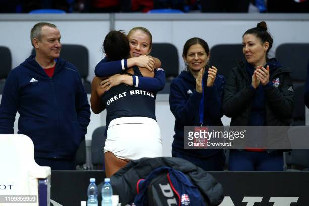 Great Britain's Heather Watson celebrates with team mate Katie Swan after she wins her singles match against Rebecca Sramkova of Slovakia during the...