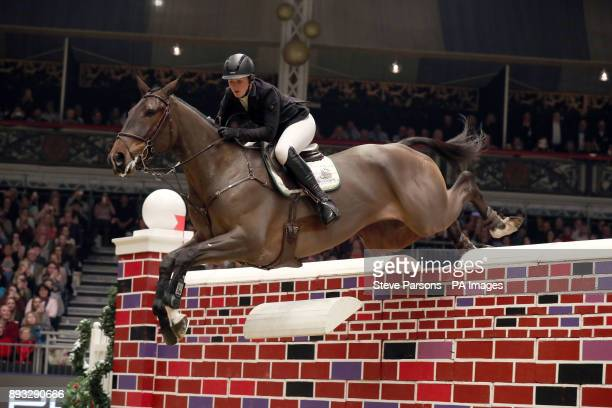 Great Britain's Holly Smith riding Quality Old Joker competes in the Cayenne Puissance during day three of the London International Horse Show at...