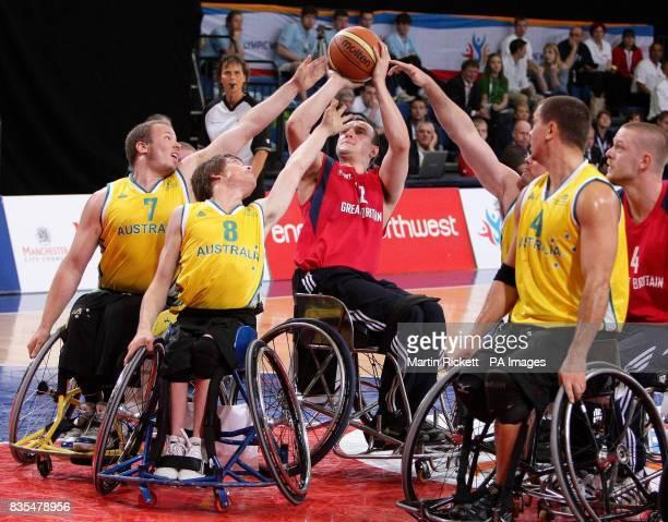 Great Britain's Ian Sagar shoots against Australia's Shaun Norris and Kim Robbins during the Wheelchair Basketball match at the Manchester Regional...