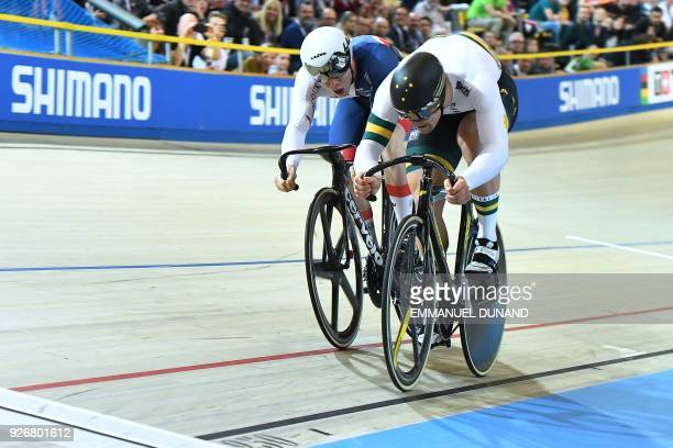 Great Britain's Jack Carlin and and Australia's Matthew Glaetzer compete in the men's sprint gold medal race during the UCI Track Cycling World...